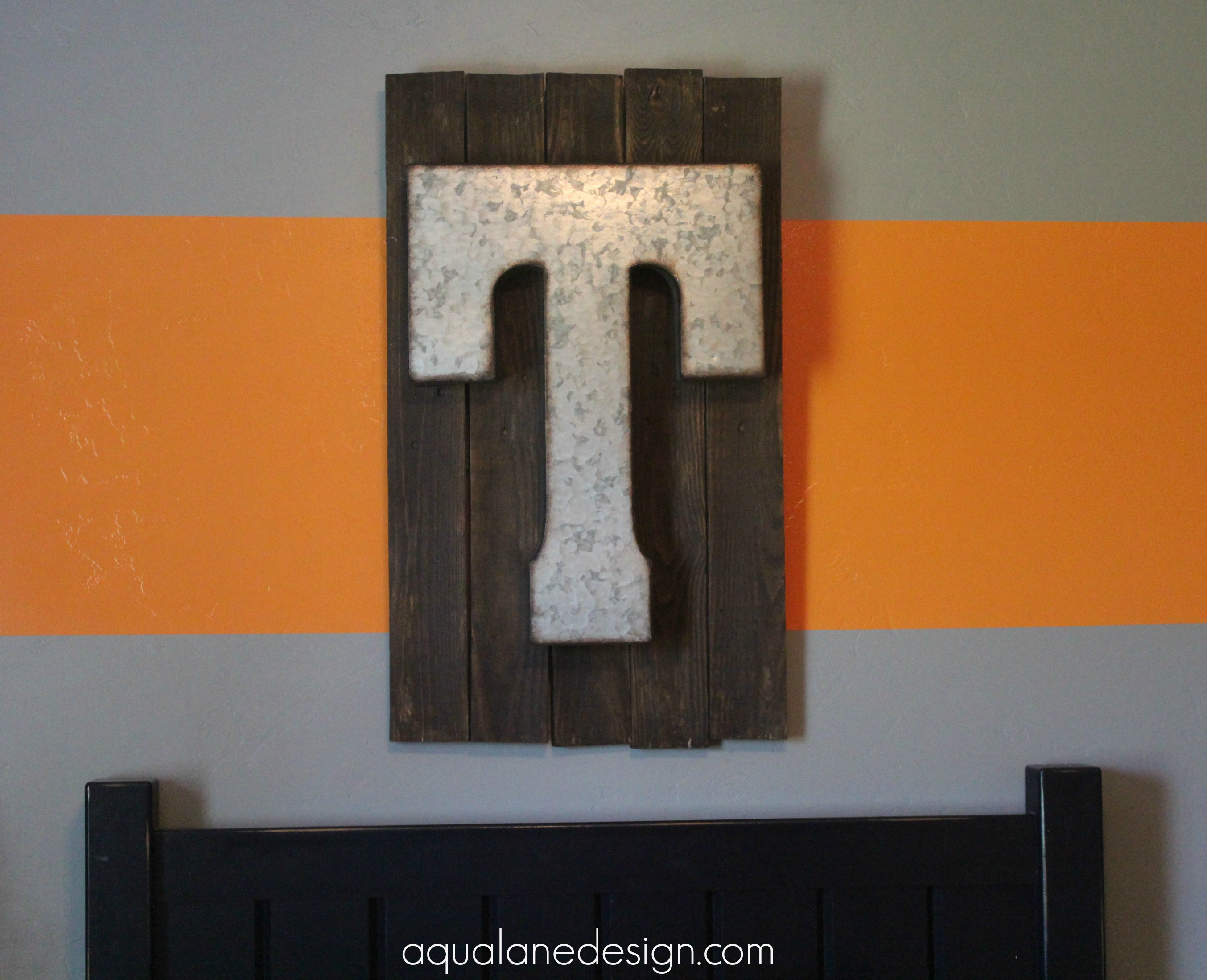 pallet t sign above bed